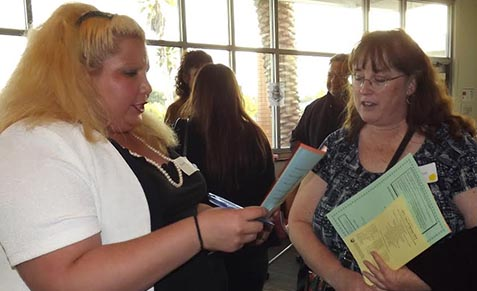 Student Kristina Rodriguez (left) talks with mentor Kim Mitchell (right) Courtesy of Debra Allen