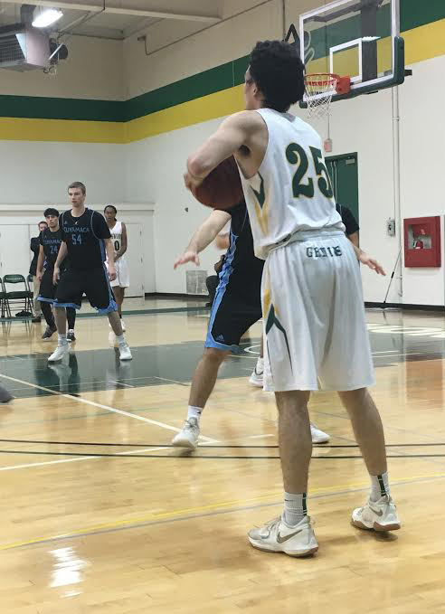 Grossmont Sophomore Guard Marc Cabrera looks for a pass.