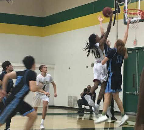 Grossmont Freshman Forward Jamal Johnson scores a layup with 2:12 left to play.