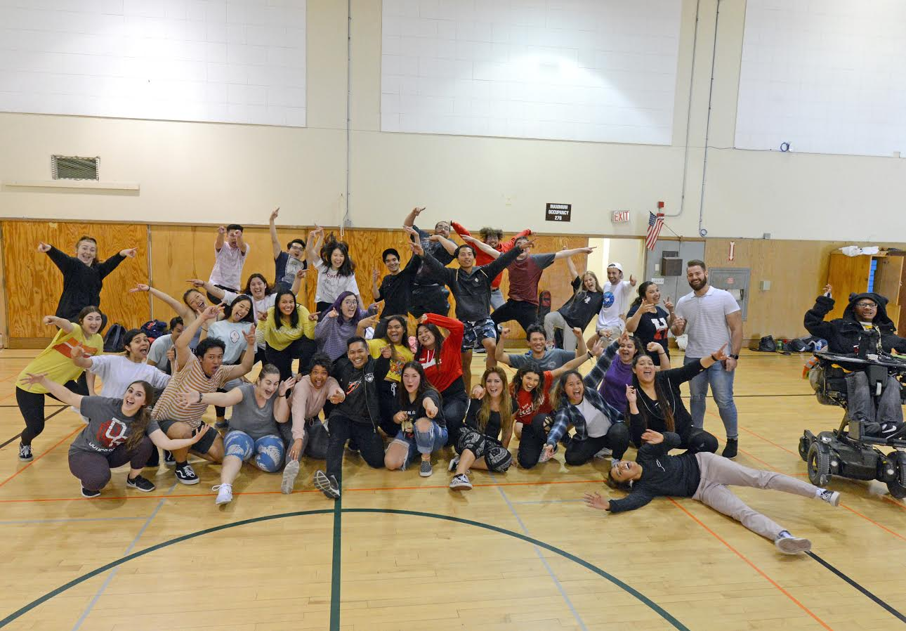 The whole class takes a break from popping and locking to pose.
