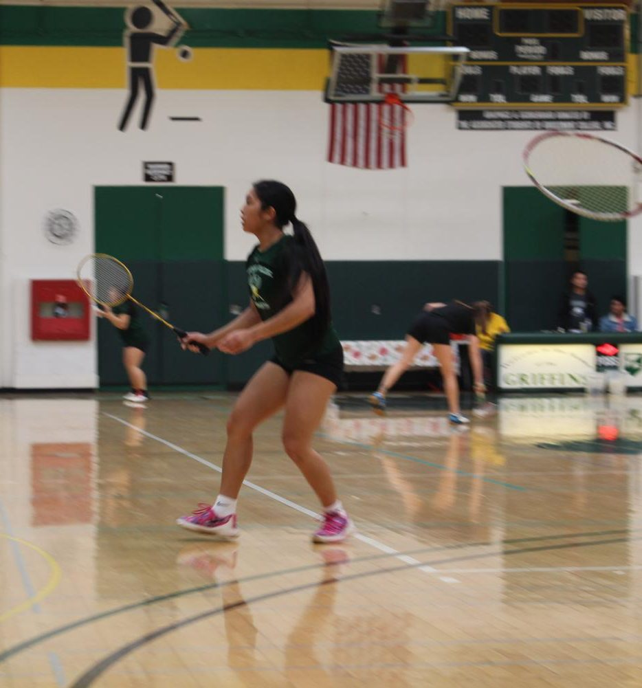 Badminton and basketball all-star athlete Drew Mendoza swats birdies on the court.