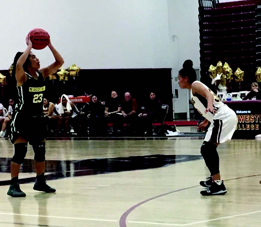 Versatile Athlete Drew Mendoza looks for an open teammate in the last basketball game of the season against Southwestern College.