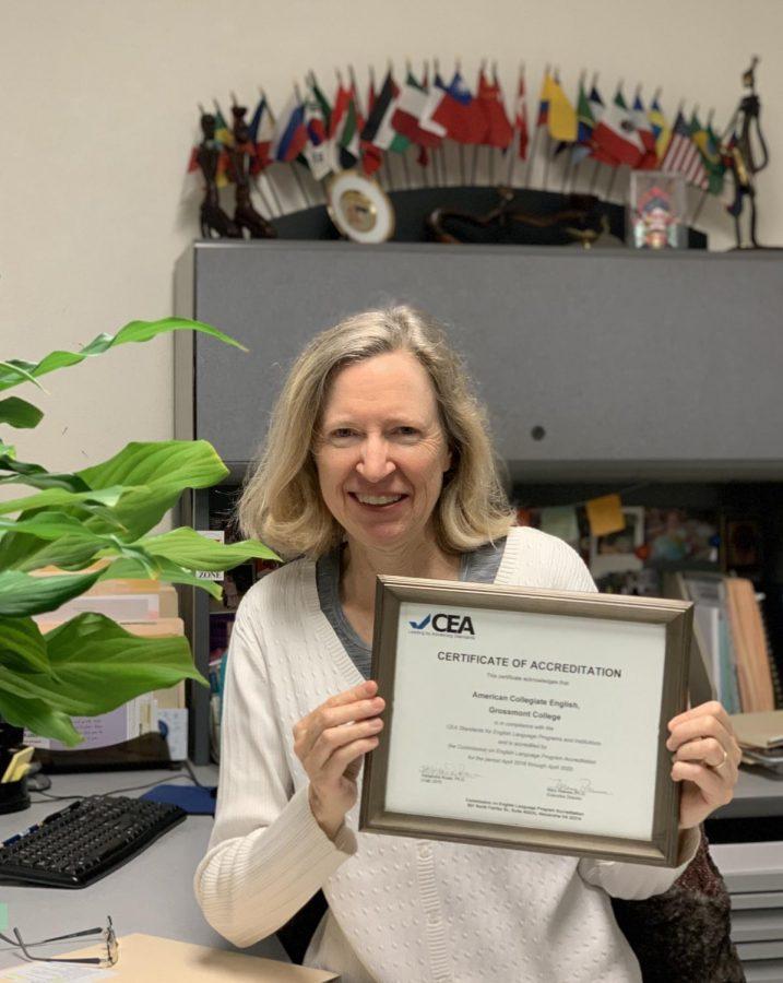 International Student Specialist for ACE, Sandy Kuntz holds certificate.