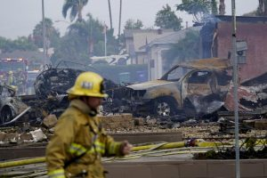 Fire crews work the scene of a small plane crash, Monday, Oct. 11, in Santee. Photo courtesy of AP News.